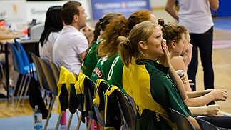 Lithuania's bench players support their teammates on the court